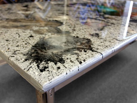A Tabletop Covered With Layers Of Resin Through Which Paint Was Swirled