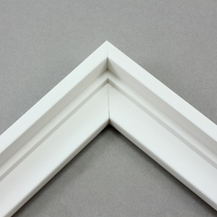 66d58edb1c7 This stair step wood floater frame has a matte white finish with a steep  upper and